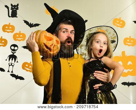 Father And Daughter In Costumes. Wizard And Little Witch
