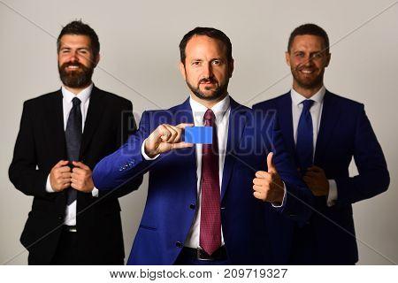 Career And Presentation Concept. Businessmen Wear Smart Suits