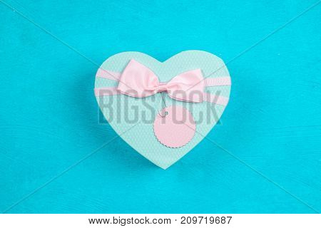 Heart shaped box on blue