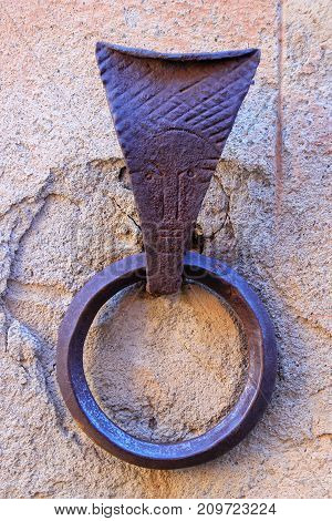 Metal ring to tie horses in Montalcino town Val d'Orcia Tuscany Italy. Such rings are a common feature of medieval architecture in Tuscany.