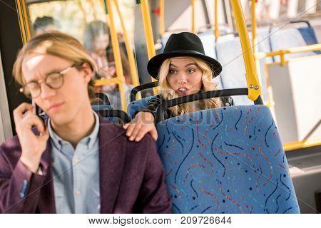 Girl Touching Man In Bus