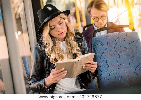 Girl Reading Book In Bus