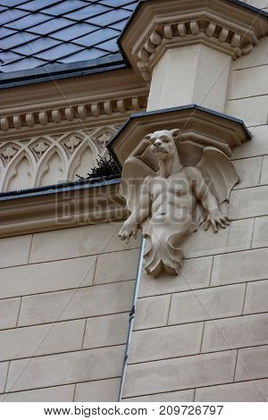 KRAKOW, POLAND - JUNE, 2012: ARCHITECTURAL DECORATION ON WALL MYTHICAL CREATURE WITH DOG'S HEAD AND HUMAN BODY