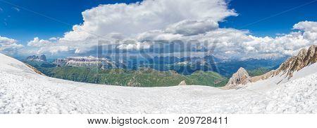Ultra wide huge panorama of Dolomites skyline from Marmolada mountain peak glacier