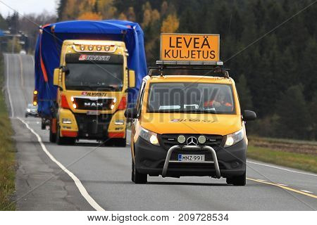JOKIOINEN FINLAND - OCTOBER 13 2017: MAN TGX wide load truck transport by Silvasti Heavy is led by pilot vehicle along highway in South of Finland.