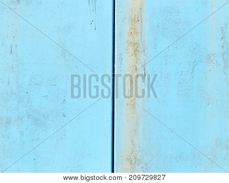background of metal painted blue . Photo of an abstract texture