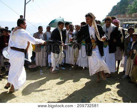 Men dancing with national traditional daggers aka Jambia at the wedding ceremony - 05-11-2009 Sanaa Yemen