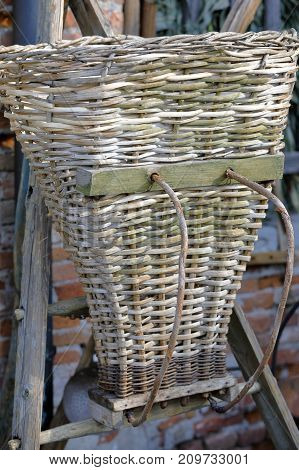 an old wicker picker picked up after harvest