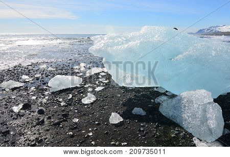 Great photo of a chunk of glacier on the beach of Iceland