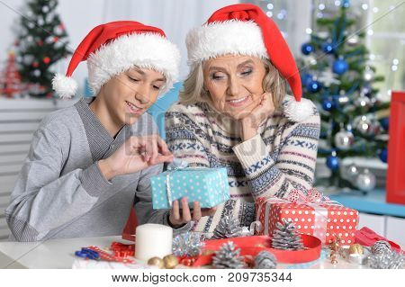 Portrait of smiling Grandmother and grandson celebrating Christmas