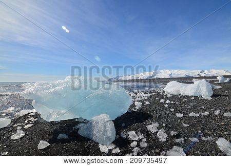 Breaktaking view of glacial ice on the beach of Iceland
