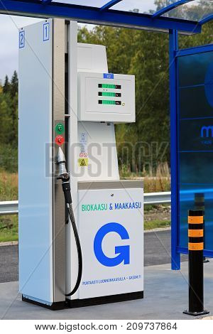 JYVASKYLA FINLAND - SEPTEMBER 22 2017: Natural gas dispenser at Gasum filling station in Jyvaskyla Finland. The station offers CNG biogas and LNG for both cars and heavy duty vehicles.