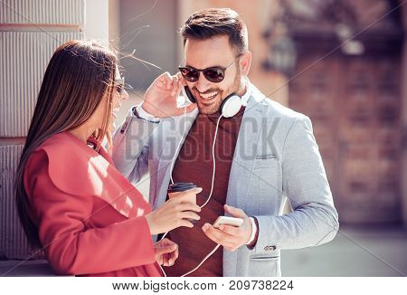 Loving couple having fun in the city and listening to music.