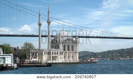 Istanbul Turkey - May 2017: Ortakoy mosque and Bosphorus Bridge connecting Europe and Asia continents