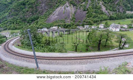 Brusio Switzerland - May 2017: Circular viaduct bridge near Brusio on the Swiss Alps