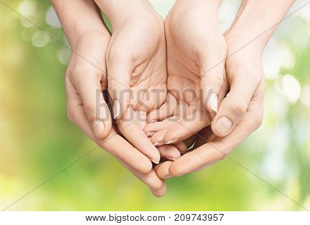 Child hands mother background small closeup holding