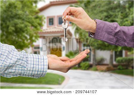 Set hand house giving keys background closeup