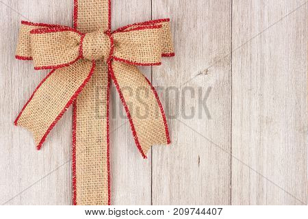 Burlap Christmas Bow And Ribbon Side Border, Above View On An Old White Wood Background