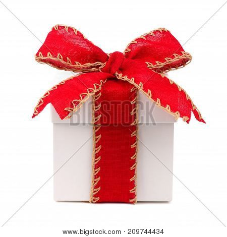 White Christmas Gift Box Wrapped With Rustic Red Bow And Ribbon Isolated On White