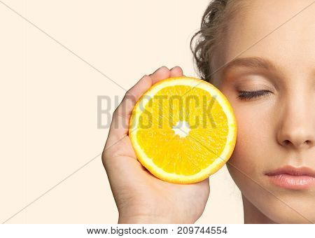 Beautiful holding girl orange close up eyes closed white