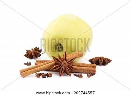 Aromatic apple, star anise, cloves and cinnamon isolated on white background