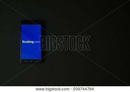 Los Angeles, USA, october 19, 2017: Booking.com logo on smartphone screen on black background.