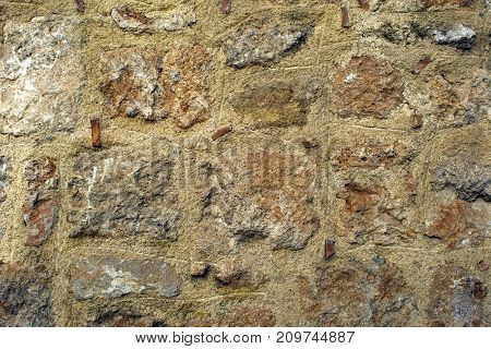 Texture on an antique wall made from stones.