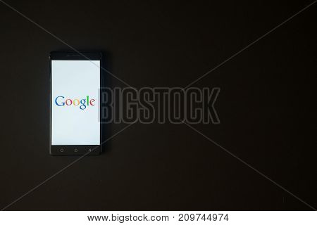 Los Angeles, USA, october 19, 2017: Google logo on smartphone screen on black background.
