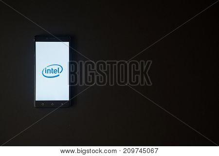 Los Angeles, USA, october 19, 2017: Intel logo on smartphone screen on black background.