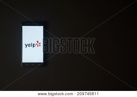 Los Angeles, USA, october 19, 2017: Yelp logo on smartphone screen on black background.