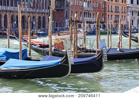 VENICE ITALY-SEPTEMBER 22 2017: Gondolas - symbol of Venice Canal Grande harbor. Gondola is iconic traditional boat very popular means of transport for tourists