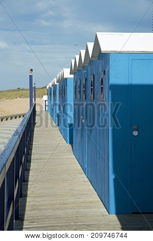 wooden chalets serving as cloakrooms, on a beach in France