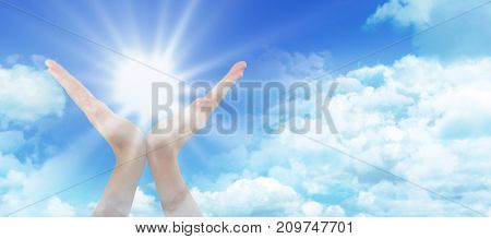 Hands gesturing against white background against idyllic view of clouds against sky