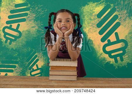 Digital composite image of light bulb on yellow spray paint against schoolgirl leaning on books stack against chalkboard in classroom