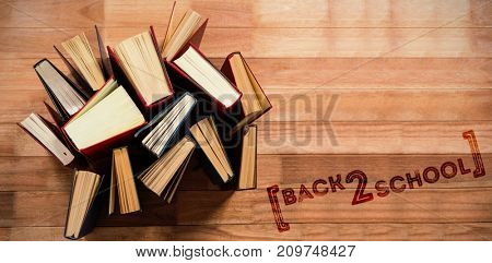 Back to school text over white background against various type of books arranged