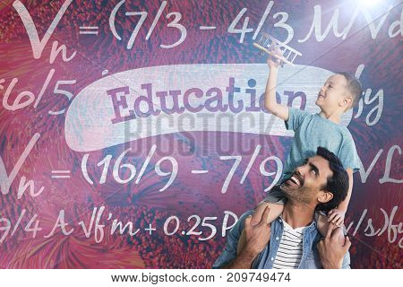 Father carrying son on shoulders against education against blue chalkboard