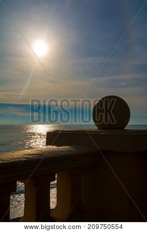The concrete fence on the background of the sea and sun over it Sochi Russia