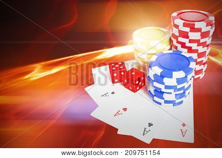 High angle view of casino tokens with dice and playing cards against glowing abstract design