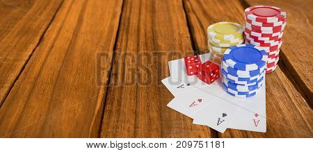 High angle view of casino tokens with playing cards and dice against high angle of wooden planks