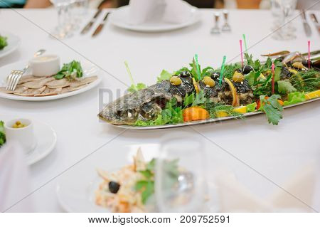 Big fish on table during catering event. Catering buffet