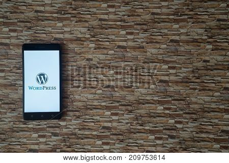 Los Angeles, USA, october 19, 2017: Wordpress logo on smartphone screen on stone facing background