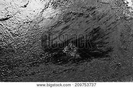 metallic black background . Photo of an abstract texture
