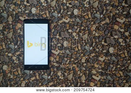 Los Angeles, USA, october 18, 2017: Microsoft bing logo on smartphone on background of small stones