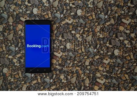Los Angeles, USA, october 18, 2017: Booking.com logo on smartphone on background of small stones