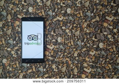 Los Angeles, USA, october 18, 2017: Tripadvisor logo on smartphone on background of small stones