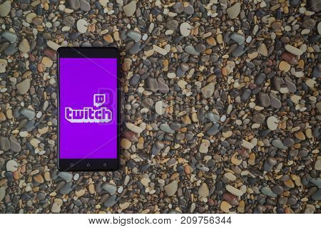 Los Angeles, USA, october 18, 2017: Twitch logo on smartphone on background of small stones