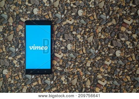 Los Angeles, USA, october 18, 2017: Vimeo logo on smartphone on background of small stones