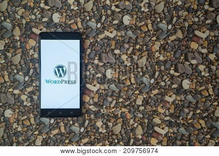 Los Angeles, USA, october 18, 2017: Wordpress logo on smartphone on background of small stones