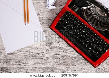 Photo of vintage red typewriter on the wooden table