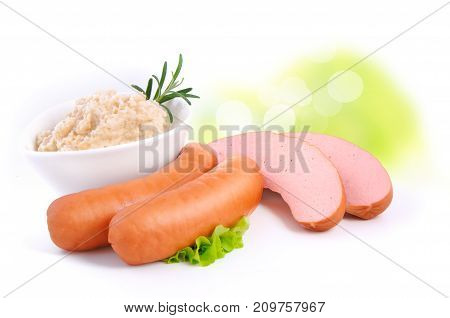 sausages with horseradish and herbs on blurred background